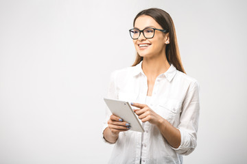 Portrait with copy space empty place of pretty charming confident trendy woman in classic shirt having tablet in hands looking at camera isolated on white background