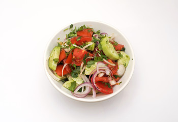 salad of cucumber, tomato, pepper and onion
