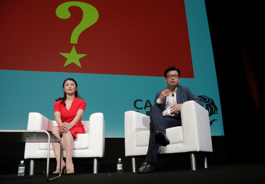 Chris Tung, Chief Marketing Officer at Alibaba, and Joy Tan, President of Global Media and Communications at Huawei Technologies, attend a conference at the Cannes Lions International Festival of Creativity, in Cannes