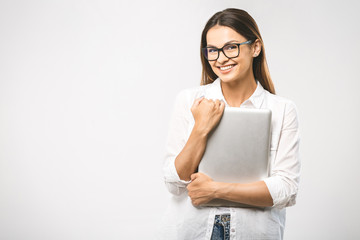 Wow! It's amazing. Portrait with copy space empty place of pretty charming confident trendy woman in classic shirt having tablet in hands looking at camera isolated on white background.