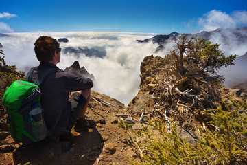 Resting man watching a landscape in the volcanic crater Caldera de Taburiente, Island of La Palma, Canary Islands, Spain