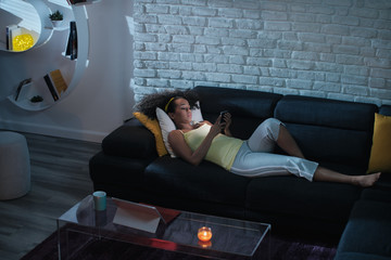 Happy Latino Woman Watching Video On Phone