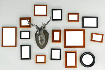 Multiple many blank small picture frames on white wall, Mockup Decoration with Clipping Path.