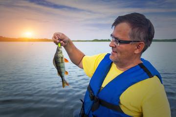 A fisherman holds a catch