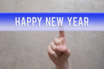 Happy new year  - finger pressing blue virtual transparent button on grunge light brown background with copy space for text or image.