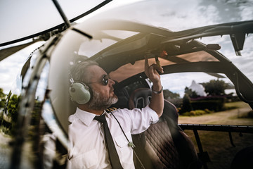 Pilot starting the controls on helicopter