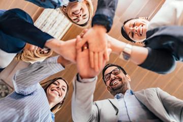 Teamwork concept. Business team joining hands together.