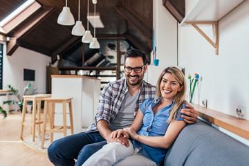 Portrait of a young couple in new apartment.