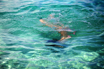 Little girl enjoying snorkeling in beautiful Croatian sea
