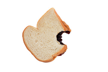 Bite out of peanut butter jelly sandwich isolated white background