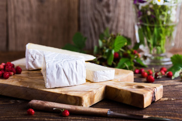 French brie cheese and wild strawberries