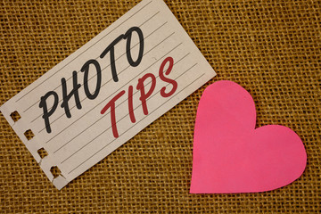 Text sign showing Photo Tips. Conceptual photos Suggestions to take good pictures Advices for great photosgraphyNotebook page Wicker background Pink Heart Black Red letters Love note.