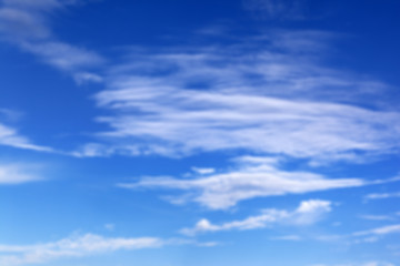 Blurred blue sky with clouds in summer sunny day