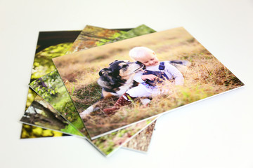 Stack of Styrene Mounted Family Portrait Prints on White Background