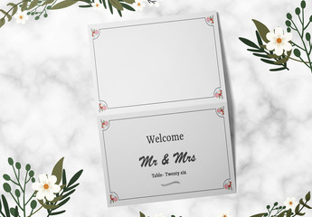 Place Card Layout with Floral Corner Elements