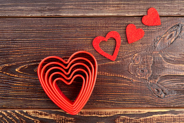 Valentines Day hearts on wooden background. Set of red hearts on dark textured wood. Happy Valentines Day.