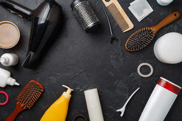 Picture of hairdresser accessories, hair dryer, combs, in circle on empty black background,