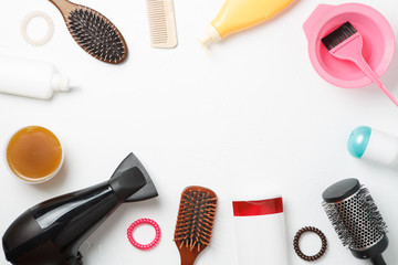 Photo accessories of hairdresser, hair dryer, combs located in circle