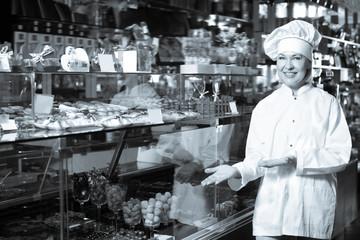 Mature woman selling chocolates