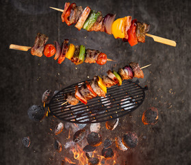 Hot briquettes, cast iron grate and tasty skewers flying in the air.