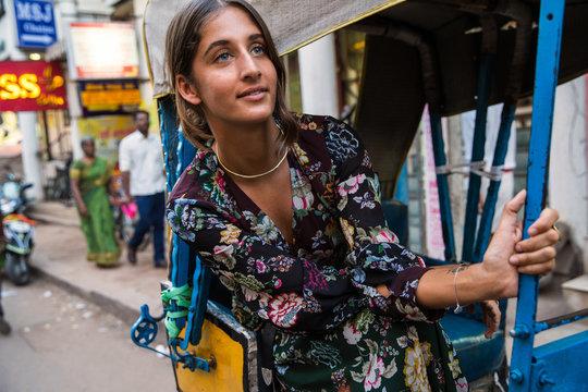 Woman riding in tuk tuk