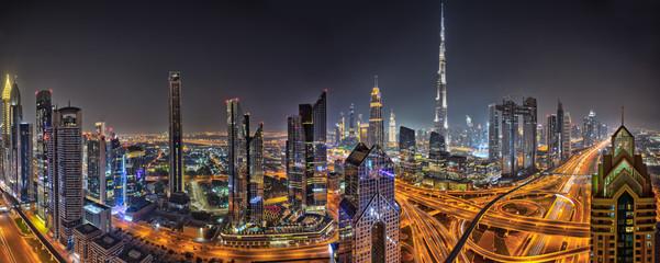 Panorama of Dubai skyline during sunset, United Arab Emirates.