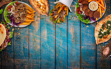 Top down view on traditional turkish meals on vintage wooden table.