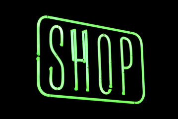 Shop neon over a black background.