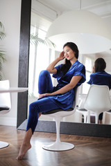 Beautiful woman wearing blue clothes