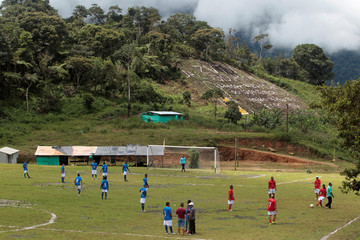 Former members of the leftist guerrilla groups ELN and FARC, members of the right wing paramilitary groups and victims of the armed conflict in Colombia participate in a soccer match for the peace in Dabeiba