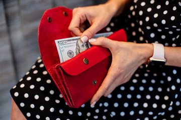 Girl holding a red money wallet.