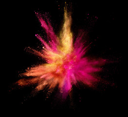 Explosion of coloured powder isolated on black background. Freeze motion of abstract colors shape in sphere shape