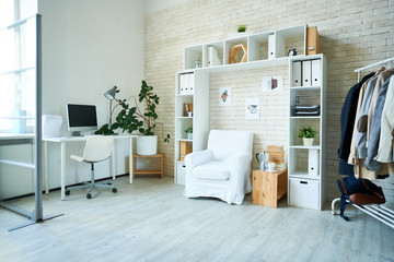 Interior shot of studio with modern style and comfortable working area in bright light.