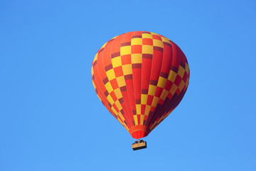colored balloon with people flying in the sky in Cappadocia