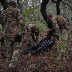 Border patrol agents apprehend an injured illegal immigrant from Honduras in Falfurrias, Texas