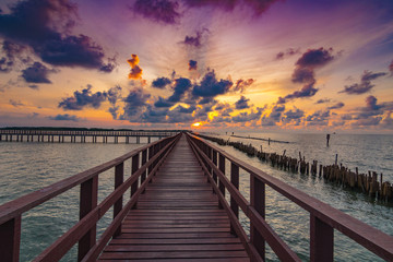 The red bridge and sun up in cloud blue sky back ground. bridge cross sea.Thailand landscape .
