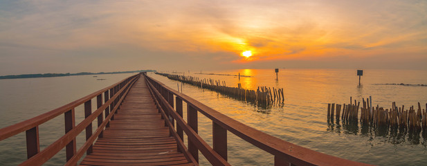 In the morning The red bridge and sun up on horizon.  bridge cross sea in Thailand .Thailand landscape .