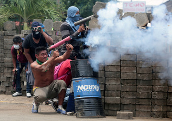 A demonstrator fires a homemade weapon against police during a protest against the government of Nicaraguan President Daniel Ortega in Masaya