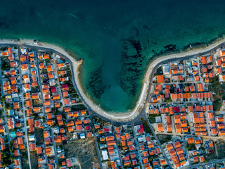Island Vir bay with houes apartments aerial top down shot with drone