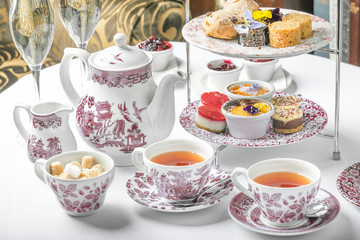 old school style tea at five afternoon service sandwich set cake sweet traditional table hotel cheesecake sugar pot china cup