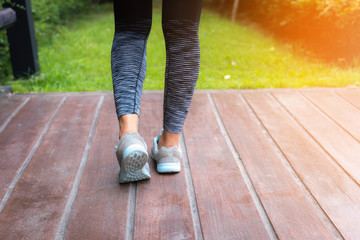 Sporty woman step to running on the garden, Sport and healthy concept