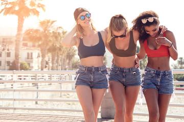 Three smiling happy girls having fun on vacation.