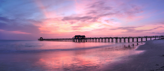 Pink and purple sunset over the Naples Pier