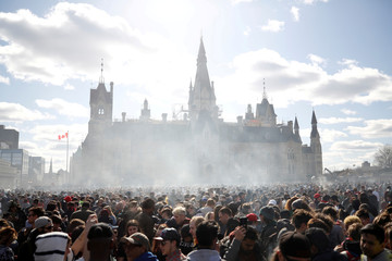 Smoke rises during the annual 4/20 marijuana rally on Parliament Hill in Ottawa