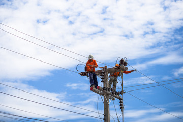 14 june 2018:The electricians are repairing and putting on new wires to keep up the light at night. Must use specialized capabilities in the work In Phetchaburi Province, Thailand