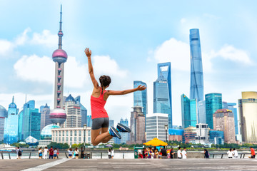 City success urban woman joy jumping in Shanghai