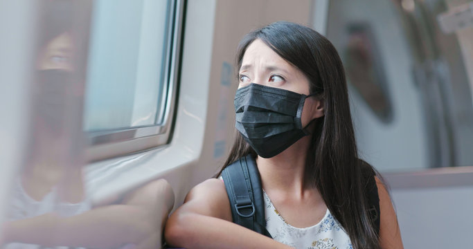 Woman wearing mask and take the train in Taipei city
