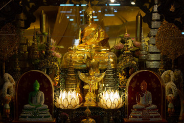 statue old buddha on shelf in temple at Ayutthaya Thailand