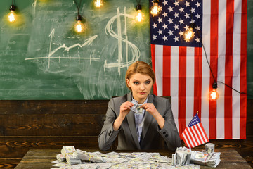 Woman with dollar money for bribe. American education reform at school in july 4th. Independence day of usa. Economy and finance. Patriotism and freedom. Income planning of budget increase policy