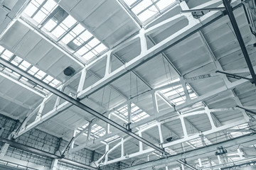 ceiling of industrial building inside bottom view. roof with top lighting